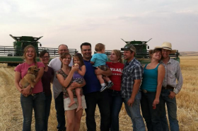 A family picture taken during wheat harvest. The picture includes Colleen and Rodney Jacobson, and her three older siblings and their families, which have since grown threefold. She now has 6 nieces and nephews, with another on the way!