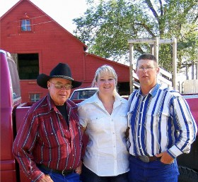 Dawn's Dad, herself, and older brother, stop for a picture after a long day of moving bulls.