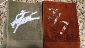 My first set of towels....that is suppose to be a lady bronc rider